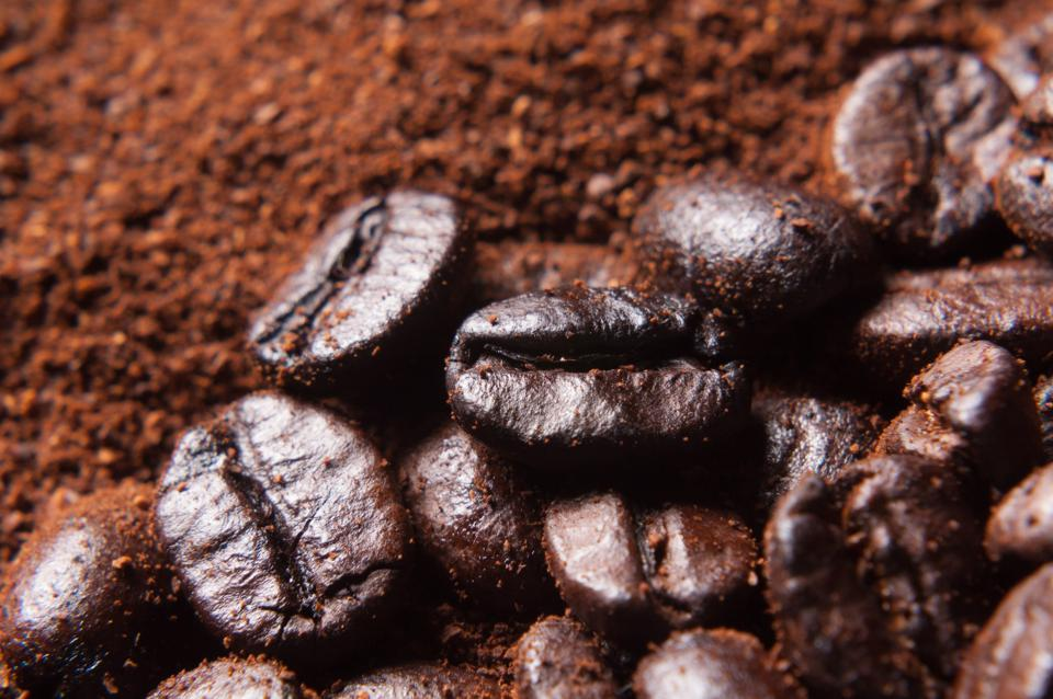 Close-up of coffee beans and coffee powder