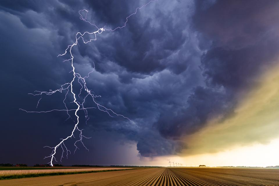 Thunder striking over an agricultural field