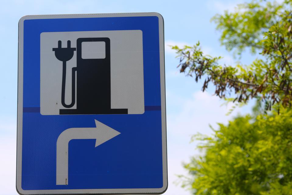 car charging road sign.