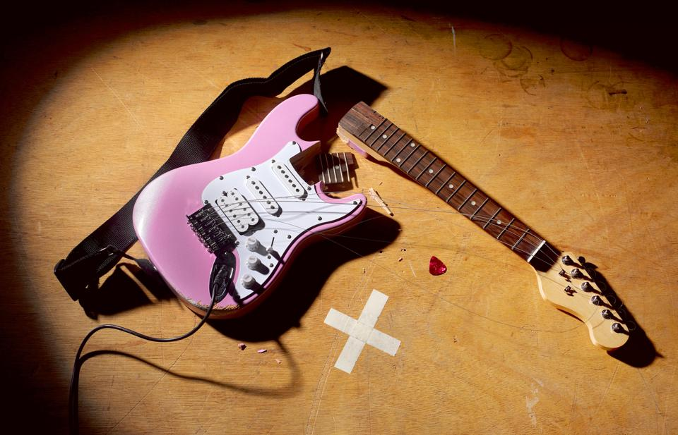 Smashed Guitar at end of rock and roll performance