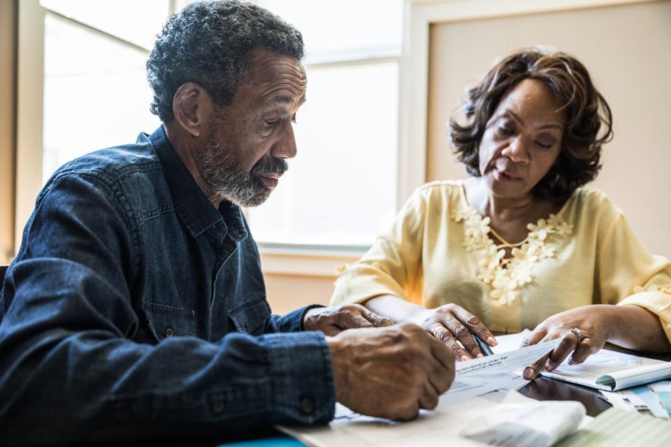 Senior couple discussing retirement planning