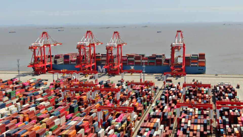 Containers Sit Stacked At Yangshan Deep Water Port