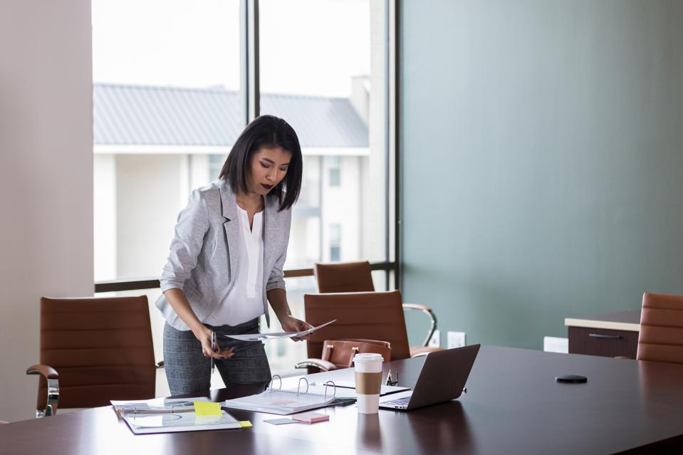 Businesswoman organizes documents
