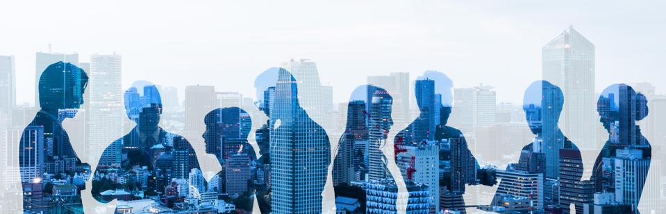 Double exposure of group of businessperson and cityscape.