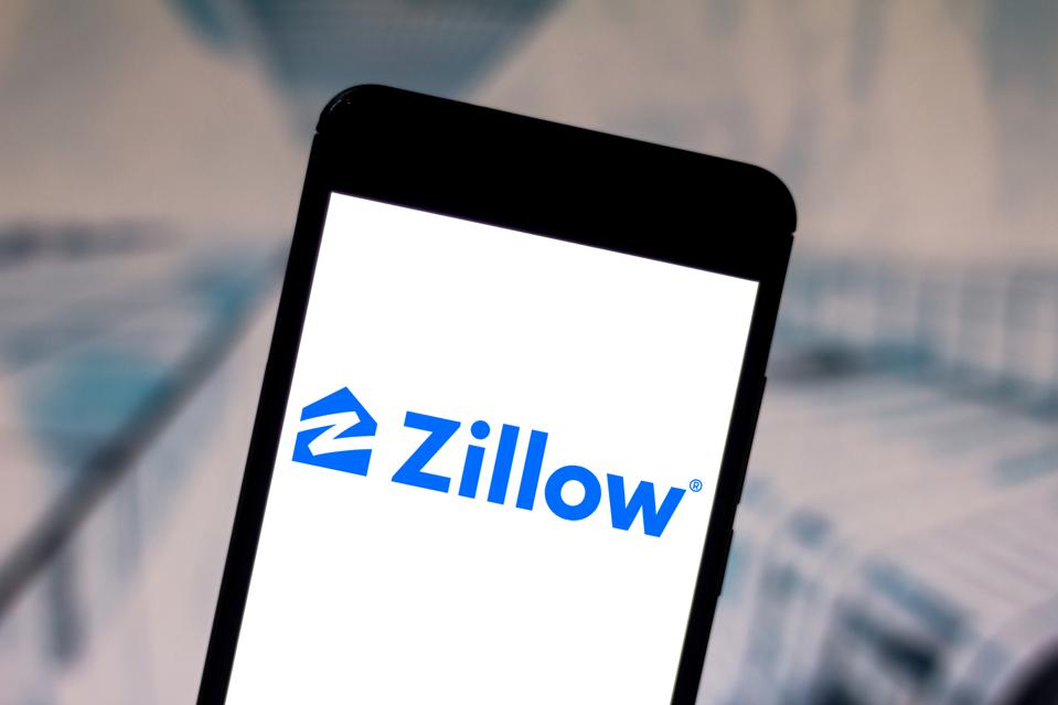 In this photo illustration the Zillow Group logo is seen...