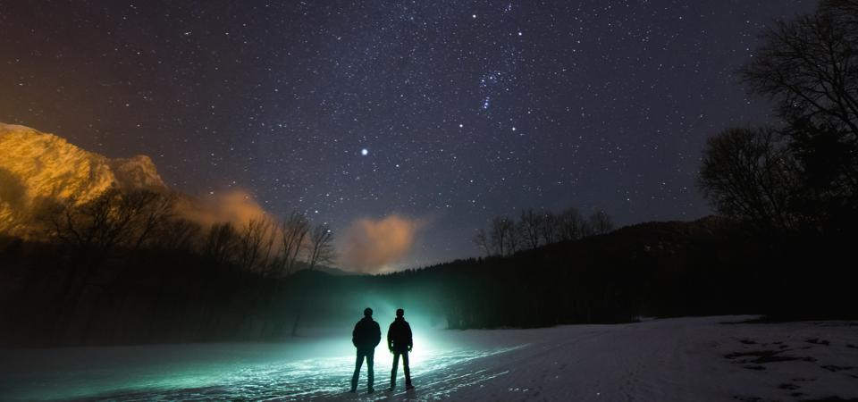 Winter stars are shining in the sky, with Sirius in the center.