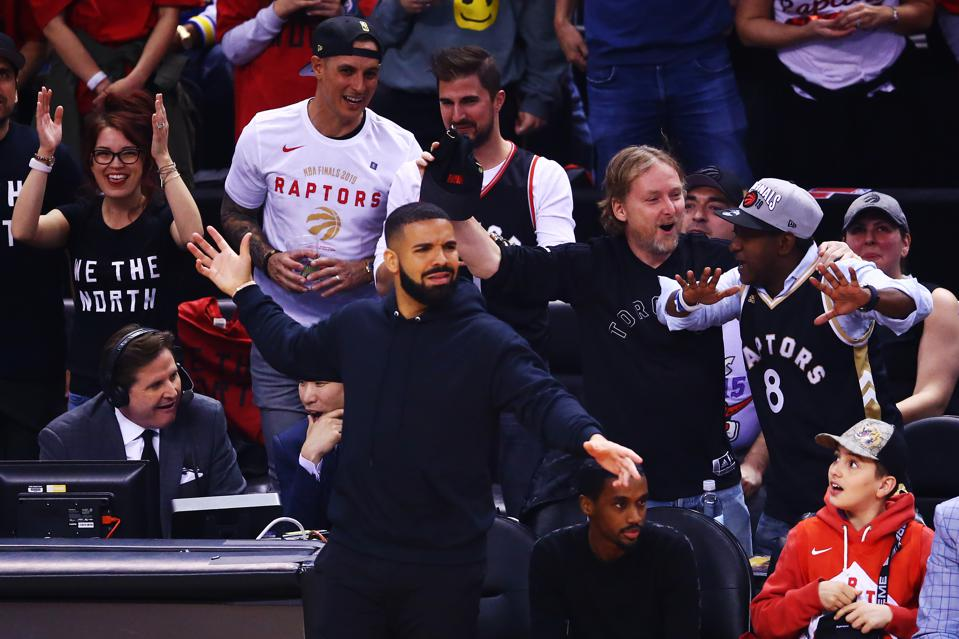 Drake cheering on the Toronto Raptors at Scotiabank Arena during the 2019 NBA Finals.