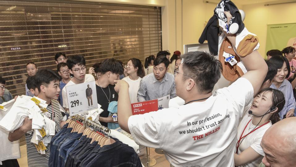 Customers Buy KAWS x Uniqlo Collaborative Collection In Jinhua