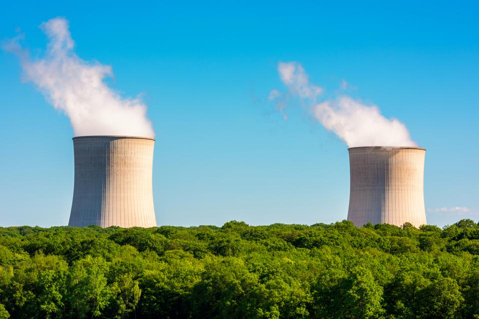 Steaming Cooling Towers at Nuclear Power Plant
