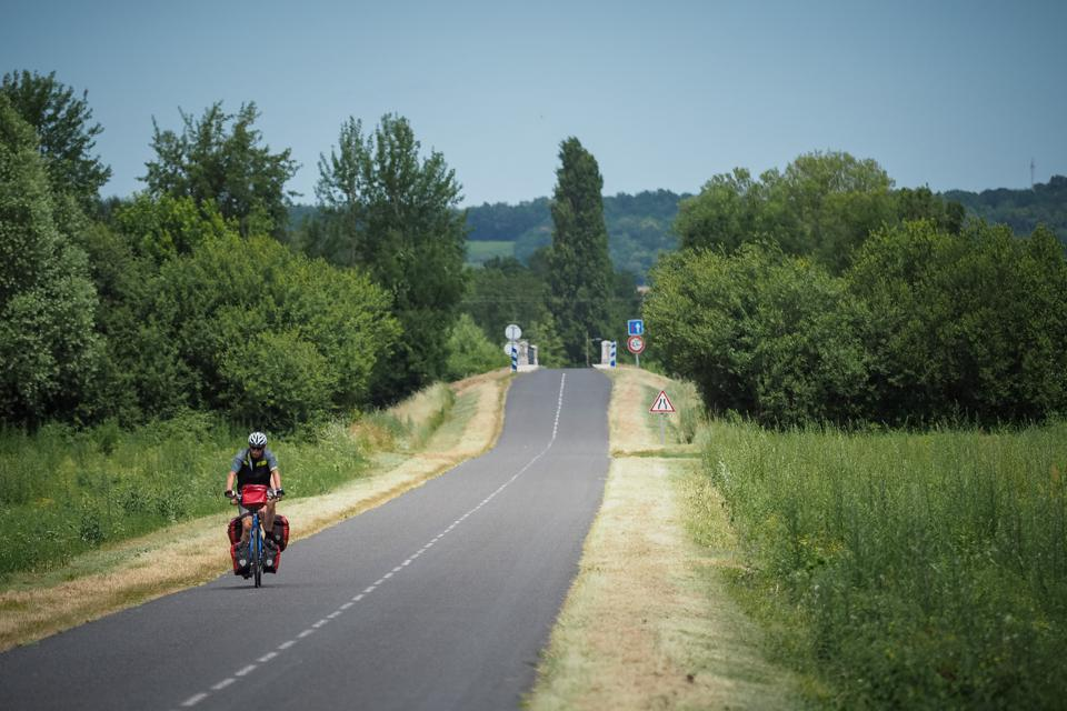 Cyclist on two-way country road in Burgundy France