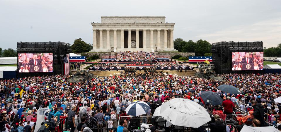 President Donald Trump speaking at the National Mall in...