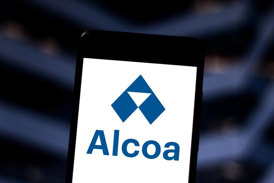 In this photo illustration an Alcoa logo seen displayed on a...