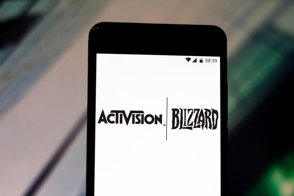 In this photo illustration an Activision Blizzard logo seen...