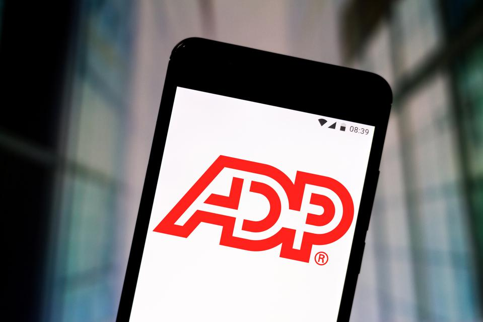 In this photo illustration an Automatic Data Processing (ADP...