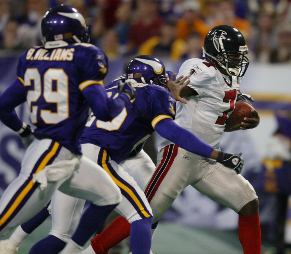 Minneapolis MN, 12/1/02 Vikings vs Atlanta--Vikings Michael Vick runs pass the Vikings defenders for a 28 yard touchdown run in the 3rd quarter.
