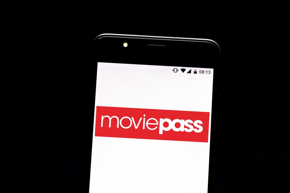 In this photo illustration a MoviePass logo seen displayed...