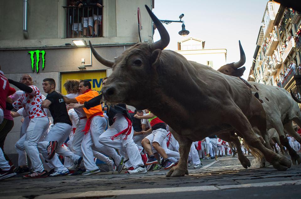 Participants run next to Nunez del Cuvillo fighting bulls on the sixth bullrun of the San Fermin festival in Pamplona, northern Spain on July 12, 2019.