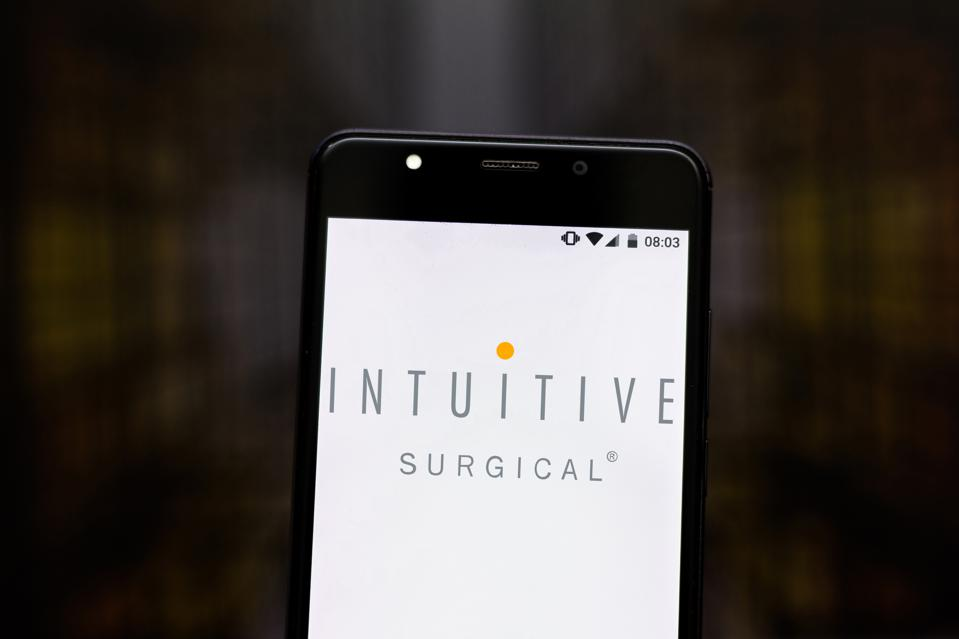 In this photo illustration an Intuitive Surgical logo seen...