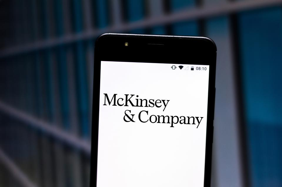 McKinsey & Company logo displayed on a smartphone.