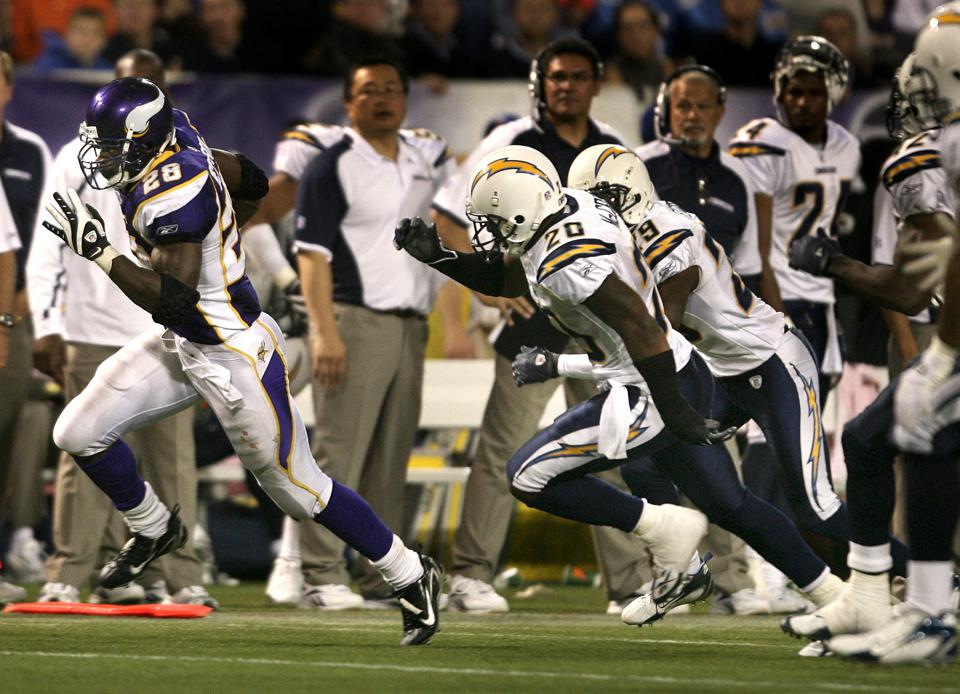 JERRY HOLT ¥jgholt@startribune.com 11/4/2007 Vikings vs Chargers-----Adrian Peterson dashed for a 46-yard touchdown run passed Chargers Marion McCree, and Drayton Florence in the 4th quarter. Peterson finished the game with 296 yards rushing helping Mi