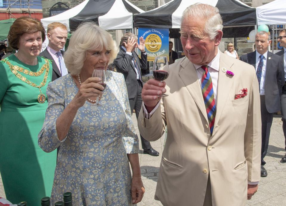 Prince Charles and Camilla, Duchess of Cornwall gesture during their visit to celebrate the recent restoration of historic buildings and to attend the Community Festival of Food and Crafts, in Tavistock, south west England on July 16, 2019. (Photo by Arthur Edwards / various sources / AFP) (Photo credit should read ARTHUR EDWARDS/AFP/Getty Images)