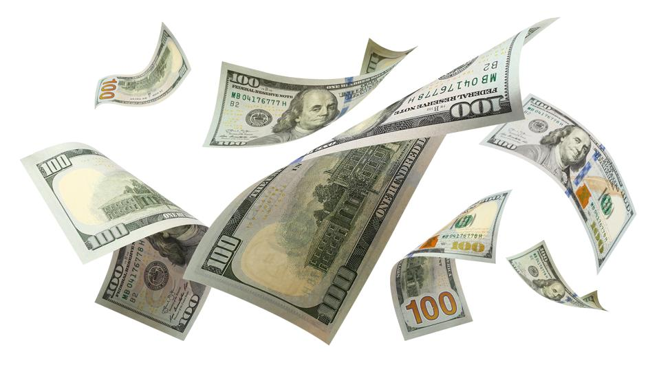Flying 100 American dollars banknotes on white