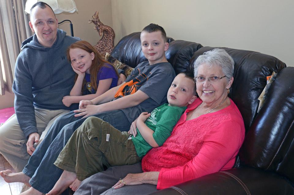 (Troy Hokanson, eight-year-old Katherine, 11-year-old Michael, five-year-old Matthew and Karen Hokanson (Troy's mother and the children's grandmother), sat on the couch in Karen Hokanson's apartment in the Hokanson's multigenerational house in Lakeville.