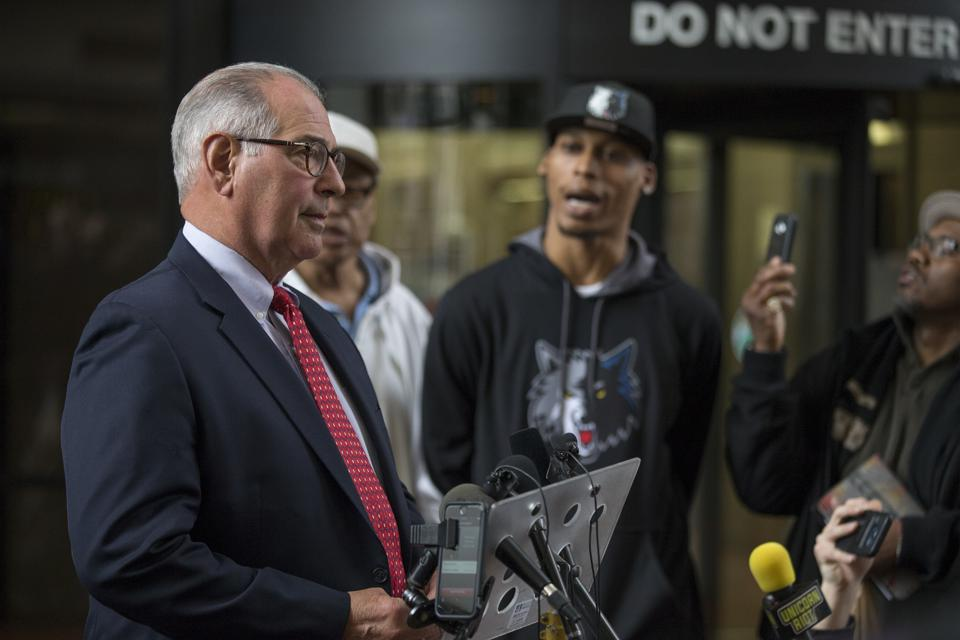 Hennepin county attorney Mike Freeman left was interrupted by Cameron Clark as he disagreed with the 15 years sentencing that Allen Scarsella received for shooting him and 4 other men Wednesday April 26, 2017 in Minneapolis, MN.]  JERRY HOLT • jerry.