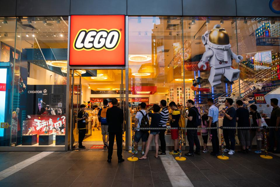 Customer in a queue in front of a new Lego store in Shanghai