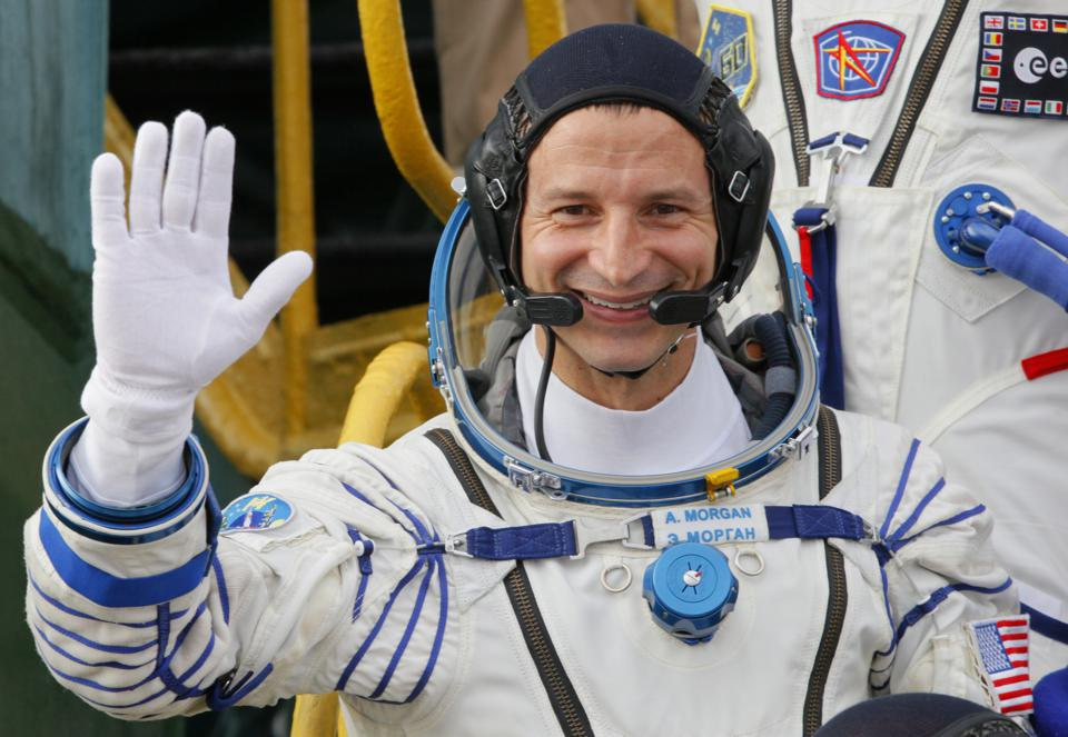 NASA astronaut Andrew Morgan waves during boarding at the Russian-leased Baikonur cosmodrome in Kazakhstan on July 20.