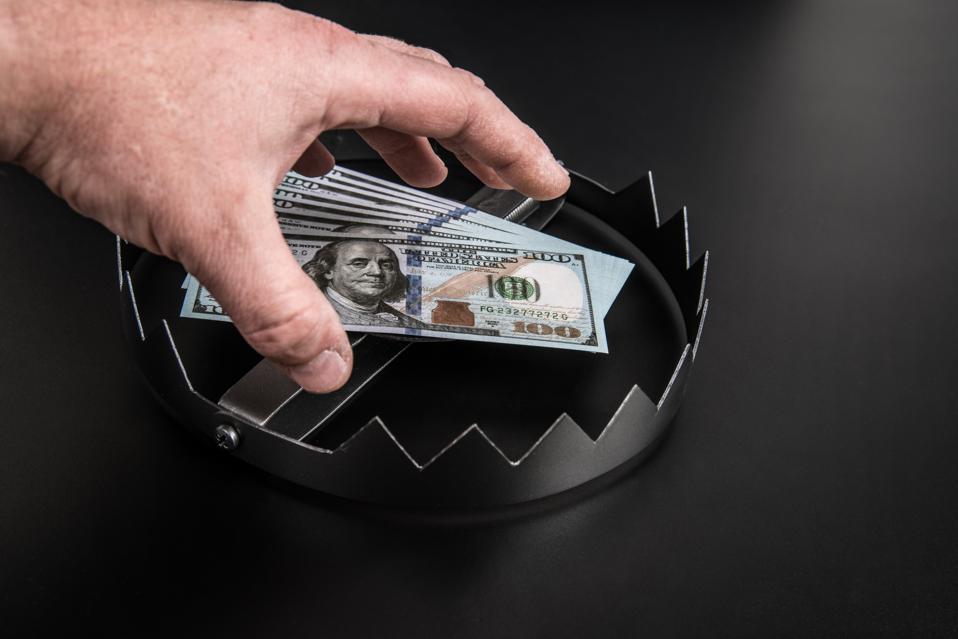 Hand trap for dollar bill, money.
