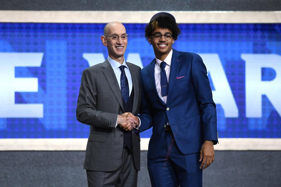 0cfa4c9efda NEW YORK, NEW YORK - JUNE 20: Jordan Poole poses with NBA Commissioner Adam  Silver after being drafted with the 28th overall pick by the Golden State  ...