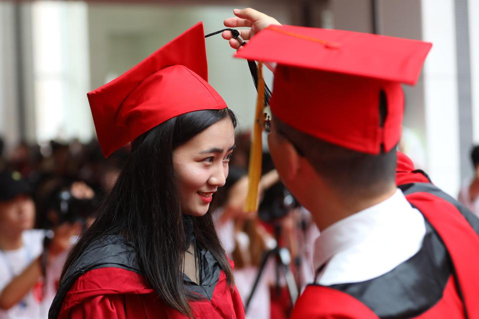 Chinese College Students Attend Graduation Ceremony