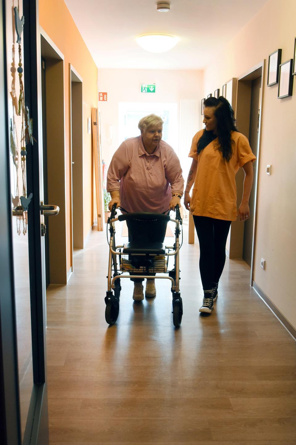 Schoolgirl nursing caregiver in senior citizens' home