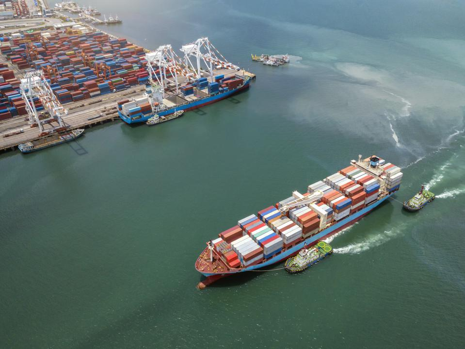 Aerial view Container cargo ship in the sea carrying to Terminal Port,Industry business logistic and transportation in Thailand