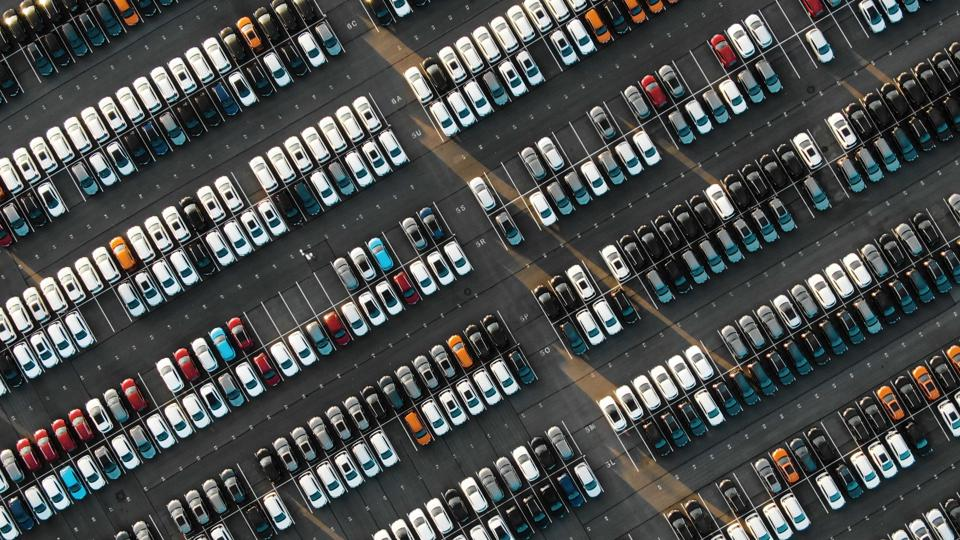 Aerial short of cars in parking lot