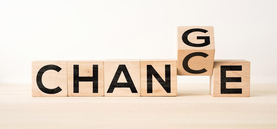 Close-Up Of Wooden Blocks With Change Chance Text On Table Against White Background
