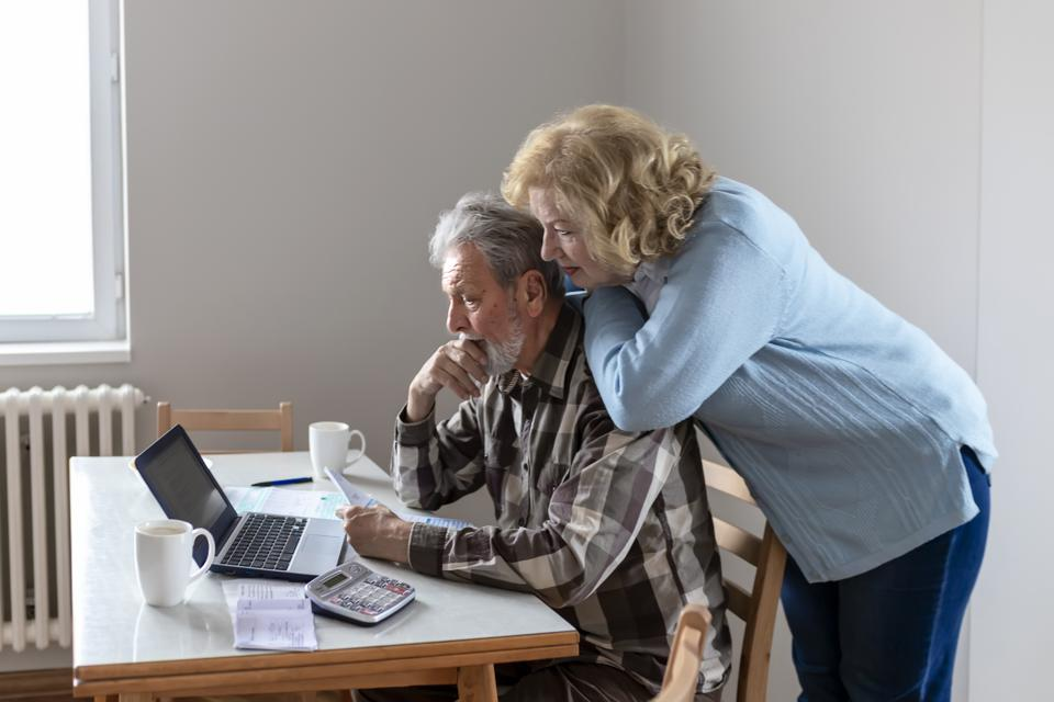 Senior Couple Doing Some Paperwork and Calculations at Home