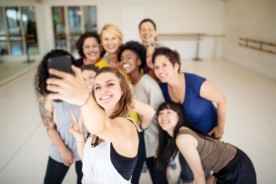 Fitness dance group taking a selfie