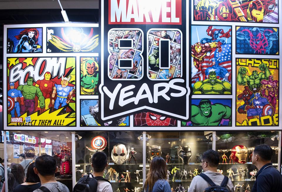 Visitors and customers seen at Disney's Marvel Studio booth...