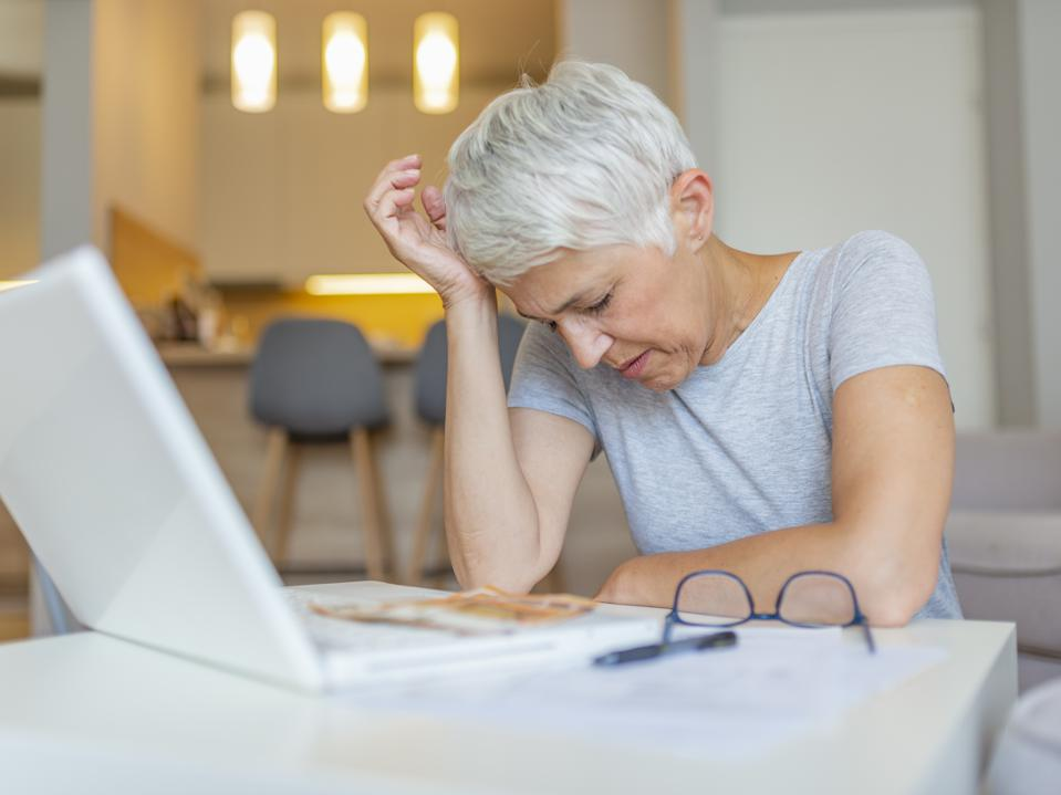 Woman dealing with retirement savings taxes.