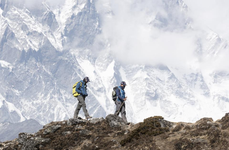 Nepal, Solo Khumbu, Everest, Mountaineer and sherpa walking in the mountains