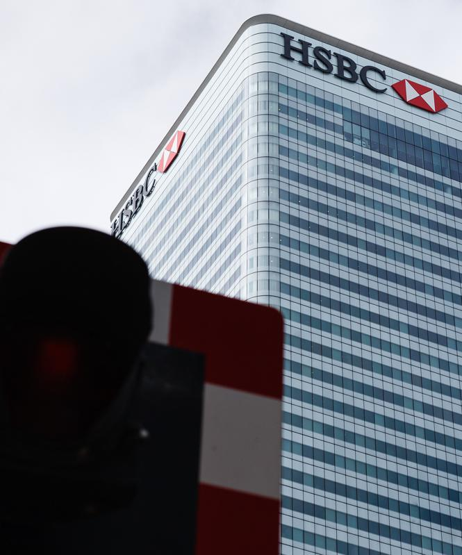 The global headquarters of HSBC, 8 Canada Square, stands in...