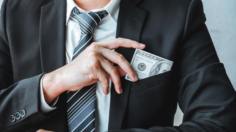 Corruption and Bribery,Businessman giving dollar bills corruption bribery to business manager to deal contract
