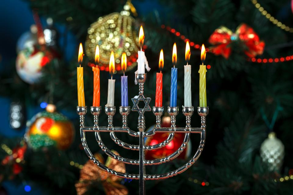 Close-Up Of Illuminated Chanukah Candles And Christmas Decorations