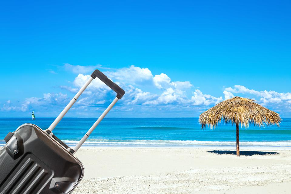 Beach with suitcase.