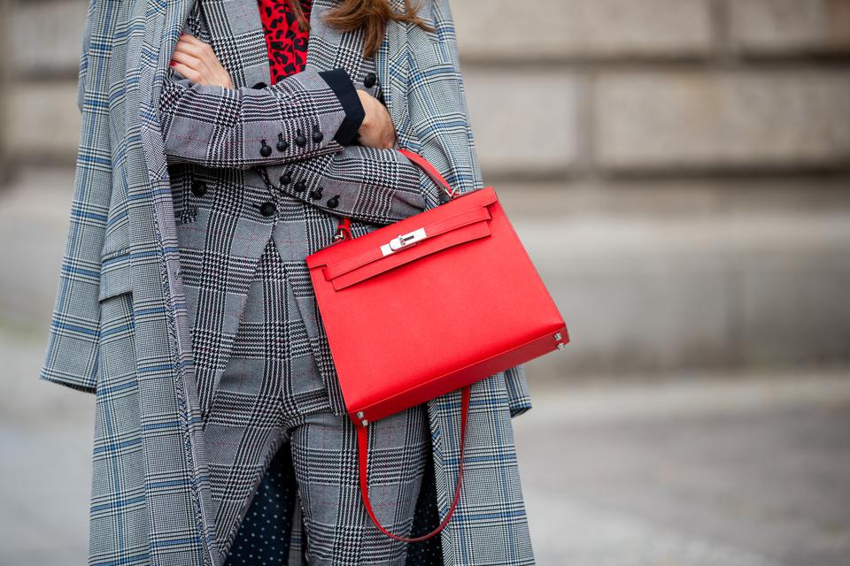 Designer handbags, like this red Hermès Kelly Bag, have become fashion's best investment