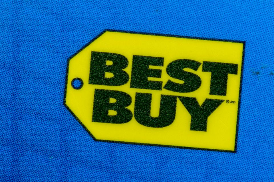 In this photo illustration you can see the Best Buy logo...
