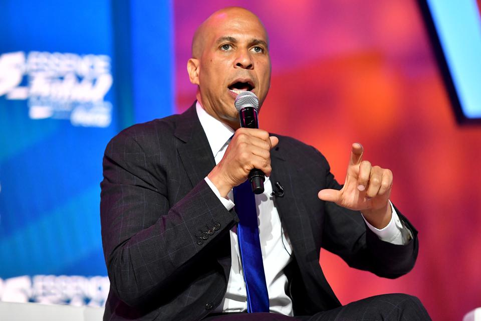 Cory  Booker speaks on stage at 2019 ESSENCE Festival Presented By Coca-Cola in New Orleans, Louisiana. Photo by Paras Griffin/Getty Images for ESSENCE.