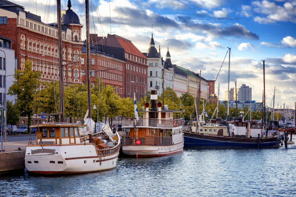 Beautiful cityscape, Helsinki, the capital of Finland, view of the embankment with boats and houses, travel to Northern Europe